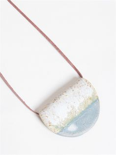 <div>- A hand made necklace with half moon shaped ceramic pendant</div>    <div>- Leather adjustable cord</div>    <div>- Drop length 50cm</div>    <div></div>    <div>Composition: Ceramic, leather</div>    <div></div> #TheArkClothingCompany