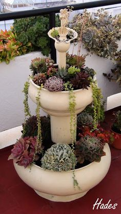 Another tiered planter that would look great in your yard this summer. Succulent Gardening, Garden Planters, Container Gardening, Above Ground Garden, Tire Craft, Tiered Planter, Tyres Recycle, Cottage Art, Bottle Garden