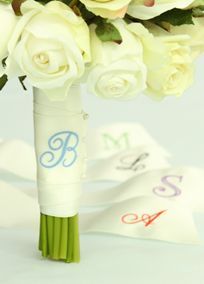 "Wrap your bouquet in this beautiful personalized satin ribbon, embroidered with your initial in your choice of exclusive David's Bridal colors.   Features and Facts:  Choose from script or block font.  Enter Single Initial of your choice.  Ribbon measures 30"" x 2"". View Font Options View Thread Color Options"