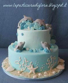 A tender cake with dolphins cake wedding cake kindergeburtstag ohne backen rezepte schneller cake cake Dolphin Birthday Cakes, Dolphin Cakes, Dolphin Birthday Parties, Beach Themed Cakes, Beach Cakes, Pretty Cakes, Cute Cakes, Fondant Cakes, Cupcake Cakes