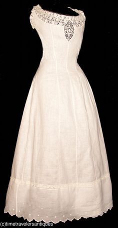 """1907 lady's fine white linen Princess style petticoat trimmed in bobbin lace and with an embroidered scalloped flounced hem. A blind back shell button closure. A 36"""" bust, 26"""" waist, and 54"""" from shoulder to front hem. ___ from time-travelers ___ photo 1"""