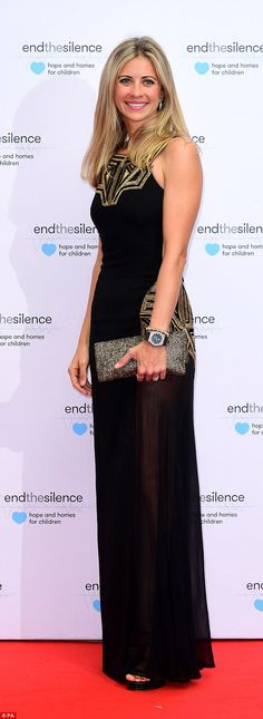 Holly Branson, 35, stunned in a long black dress with gold detailing and daring sheer pane...