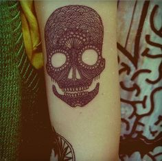 normally i think sugar skulls are not attractive tattoos. but this one is a unique take. i love the intricate lines....but they will eventually bleed into one another. one big black blob!