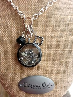 Origami Owl Vintage locket with our black enamel face. Click on the pic to order yours!
