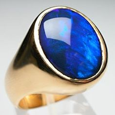 Weston Jewelry again. Custom mens black opal mounted in solid 22K gold. Isn't this simply gorgeous? I would wear it as a thumb ring.