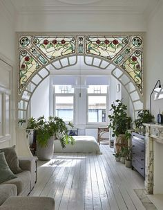 stained glass arch in interior designer anouk Taeymans' Art Nouveau apartmen. - Inspirational Interior Design Ideas for Living Room Design, Bedroom Design, Kitchen Design and the entire home. Foyer Design, Deco Design, Design Case, House Design, Design Bedroom, Home Arch Design, Small Home Interior Design, 1920s Interior Design, Art Nouveau Design