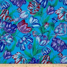 Philip Jacobs Spring 2017 Tulip Extravaganza Blue from @fabricdotcom  Designed by Philip Jacobs for Free Spirit, this cotton print fabric features vibrant hues and beautiful leaves and flowers for a spring vibe. Perfect for quilting, apparel and home decor accents. Colors include shades of blue and purple, green, dark green, maroon and magenta-red.