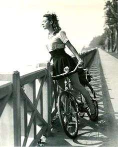 Susan Peters rides a bike. And gazes out to sea.