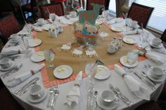 Table setting for a girls baby shower little lamb theme