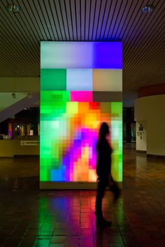 Infrared cameras capture moving images and transform them into pixilated blocks.
