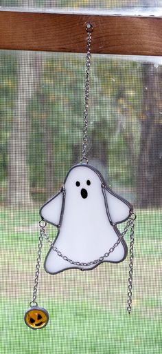 Stained Glass Suncatcher - Halloween Spooky Ghost with Pumpkin on a Chain. $20.00, via Etsy.