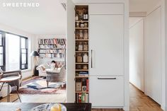 Casey and Kumar comprehensively documented the exact storage requirements they needed to accommodate, to guarantee a precise fit. They situated the fridge, freezer, and pantry just across from the kitchen, with a single integrated design that also conceals the apartment's only structural column.