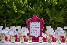 I will bring the sign and name cards- I would love a table with shots of tequila and people's names on the flags