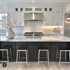 Black island white cabinets + silver