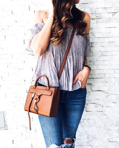 Levi's high rise distressed skinny jeans outfit. Pleated off the shoulder top. Feminine off the shoulder top. Feminine spring style. Casual spring style outfit. Neutral spring style. Rebecca Minkoff dog clip crossbody. Vince nadette slides