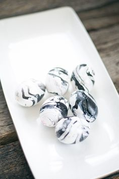 How to make black and white marbled eggs with nail polish - an easy way to upgrade your Easter eggs in a modern way. Polish from the Dollar store works fine. Need a large mouthed disposable dish.