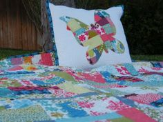 I like the patchwork applique on the pillow (pic for inspiration)