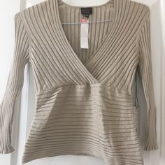 Large Taupe Exhibit A Silk 3/4 Sleeve Wrap Top This is a taupe 3/4 sleeve wrap top by Exhibit A. It is a VERY stretchy silk top! It has never been worn. It can be short near the bottom especially with a large bust, however it is comfy and soft and stretches easily. Can fit medium or large. Exhibit A Tops Tees - Long Sleeve