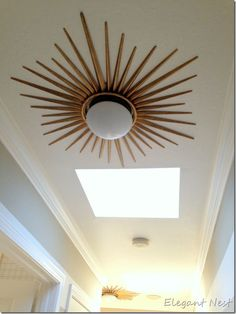 Install a starburst mirror frame around a flush mount ceiling ...:Instead of a traditional medallion, the sky is the limit for repurposing  something into a ceiling medallion to frame your light at the ceiling.,Lighting