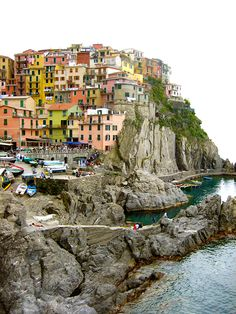 Cinque Terre, Italy,  Italy is a must go place for me.  I want to see the things my Dad saw in one of his favorite places he was stationed while in the military