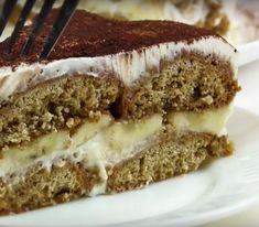 Vă prezentăm o rețetă simplă de tort fără coacere, care se prepară din ingrediente accesibile. Pentru prepararea acestui tort veți folosi biscuiți de ovăz, cremă de smântână și banane. Tortul se prepară foarte repede, este economic, dar foarte gustos, moale și apetisant. Serviți tortul cu o cafea aromată! Tort economic și rapid din biscuiți de ovăz INGREDIENTE –800 g de biscuiți de ovăz –800 g de smântână –3 banane –150 g de zahăr pudră –1 lingură de cafea solubilă –300 ml de apă clocotită…