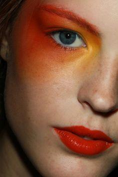 yellow - orange eye makeup with orange lipstick