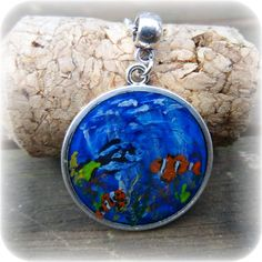 Check out this item in my Etsy shop https://www.etsy.com/uk/listing/466821794/marine-life-silver-plated-cabochon