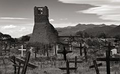 An old cemetery in Taos Pueblo with what's left of the old adobe church - the bell tower