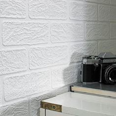 This Brick wallpaper design is sure to make an impression on the walls of your home because of its strong visual presence and textured nature. The white piece features a brick effect, suited to a whole host of different rooms and design styles. The design is also easily paintable, meaning adding a touch of colour to the piece is an easy process and can help to give it an added dimension.