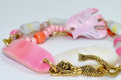 Coral Mermaid Pink White Conch Shell 3 Strand Bracelet by SeaSide Strands.