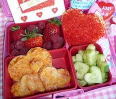 Valentine's Day school lunch - pizza hearts,  *cucumber hearts,  *strawberries and raspberries,  *a heart sprinkle cookie