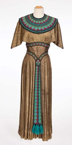 """Gold lamé Egyptian gown worn by mezzo-soprano Blanche Thebom in """"The Great Caruso"""" (c. designed by Helen Rose and Gile Steele. Ancient Egypt Clothing, Ancient Egyptian Dress, Ancient Egypt Fashion, Egyptian Fashion, Egyptian Costume, Egyptian Outfits, Egyptian Dresses, Helen Rose, Hollywood Costume"""