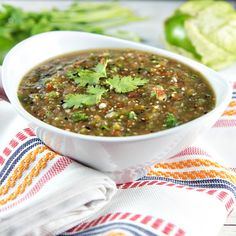Fire roasted tomatillos and cherry tomatoes pair beautifully with spicy jalapeno, onion, and garlic in this non-traditional salsa verde.