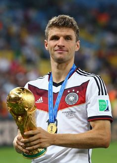 Thomas Mueller of Germany celebrates with the World Cup trophy after defeating Argentina in extra time during the 2014 FIFA World Cup Brazil Final match between Germany and Argentina at Maracana. Messi, Neymar, Fifa, Football Match, Football Soccer, World Cup Trophy, Thomas Muller, Dfb Team, Germany Football
