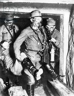 Austrian soldiers carrying an unconscious companion out of a mine gallery on the Italian front, 1918 (b/w photo)