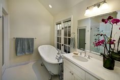 Claw foot bath tub, duel vanity, vintage master suite.
