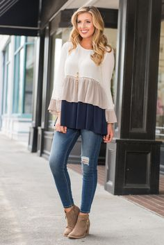 This top is certainly a triple threat! It's cute, comfy and totally trendy! We…