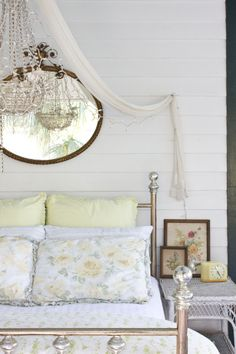 Draping with a chandelier in the middle and a mirror