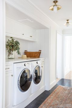Laundry room with cabinets and folding area.