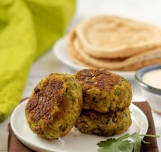 These easybaked falafel patties are sturdy with bright, fresh herbs running through them. Perfect with pitas and this simple, creamy tahini sauce!