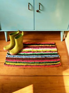 *Mirre*'s handmade rug, with boots and an aqua cabinet. I love how all the colors work together. So happy.