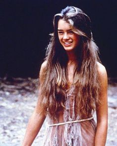 20 most iconic beach hair of all time: Brooke Shields stuns beach hair that is long and textured.