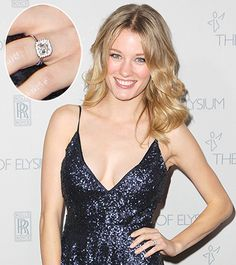 Ashley Hinshaw showed off her new engagement ring from Topher Grace on the red carpet at the Art of Elysium Heaven Gala on Jan. 10.