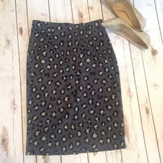 LOFT fun pencil skirt Add a little fun to a classic style with this animal print skirt with cute back zipper detail. Worn but in good condition. Fully lined. Size medium. Machine washable! 87% polyester, 11% rayon, 2% spandex. LOFT Skirts Pencil