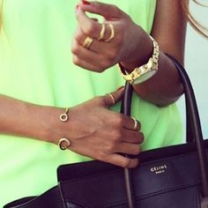 neon green top black celina bag tot red nails nail polish gold golden watch style fashion simple