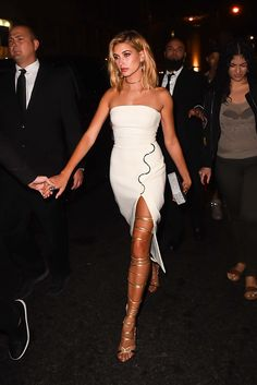 Hailey Baldwin in David Koma dress, Edie Parker bag, and DSquared2 shoes.