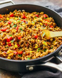 Here's an easy recipe for Southwest beef and rice skillet! Everything is cooked in just one pan: ground beef, rice, peppers, onions, beans, and corn.