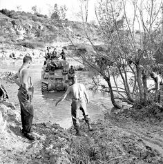 """bag-of-dirt: """" A Canadian tank crew of """"A"""" Squadron, The Ontario Regiment, Royal Canadian Armoured Corps, cross a stream in an M4 Sherman during the Italian Campaign. Near Colle d'Anchise, Campobasso, Molise, Italy. 26 October 1943. """""""