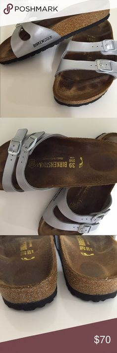 Birkenstocks Silver two strap Birkenstocks, size 39 L8, please refer to the Birkenstocks web site if your unsure of sizing. These are in excellent condition, corks and soles are in great shape! Just to big for me and I'm looking to buy Birks that fit me. Birkenstock Shoes Sandals