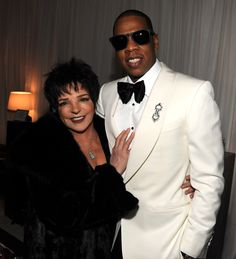 Hip Hop King Jay-Z & Musical Legend Liza Minnelli meet at Jay-Z's concert benefiting  the United Way.     Drape - White Velour